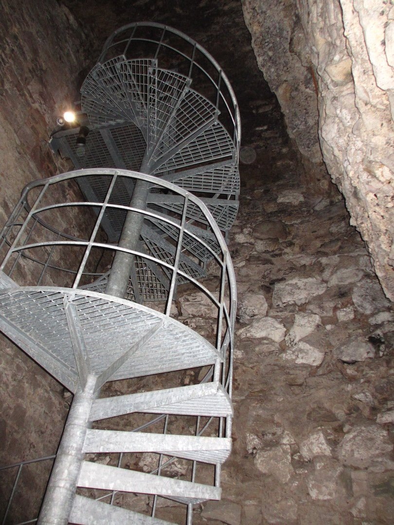 Metal spiral stair leading into the basement of David's Tower as seen on a tour