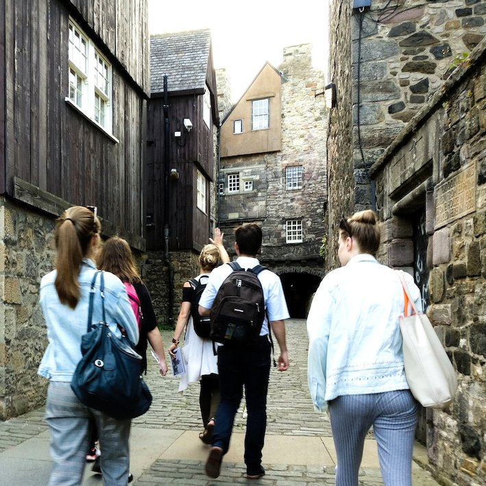 Edinburgh Tour guide walking with a group | Bakehouse Close