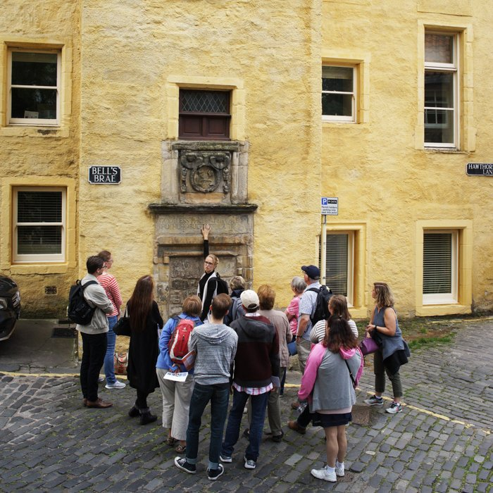 Architecture Tour group in Dean Village Edinburgh in front of Old Tolbooth