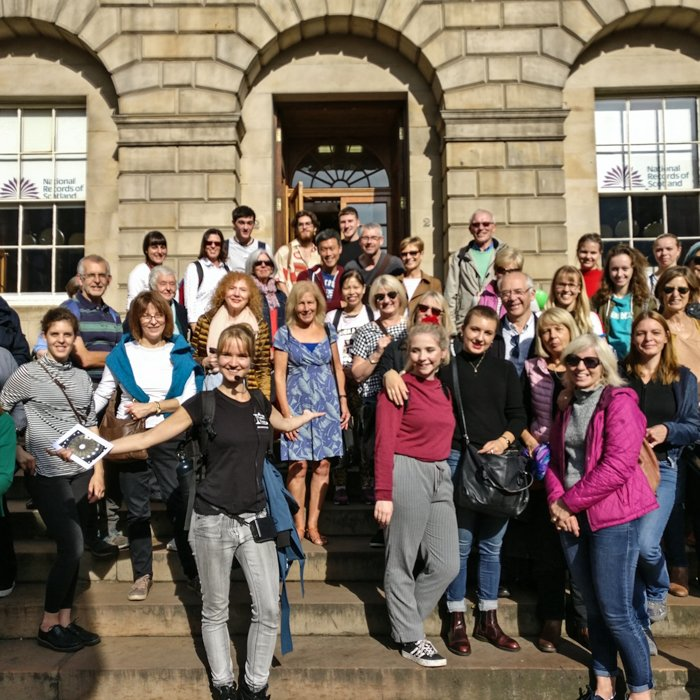 Architecture Tour Group in New town, on the stairs of Register House, sandstone building