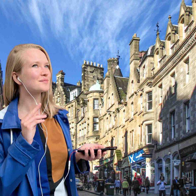A person on audio tour of Edinburgh Old Town