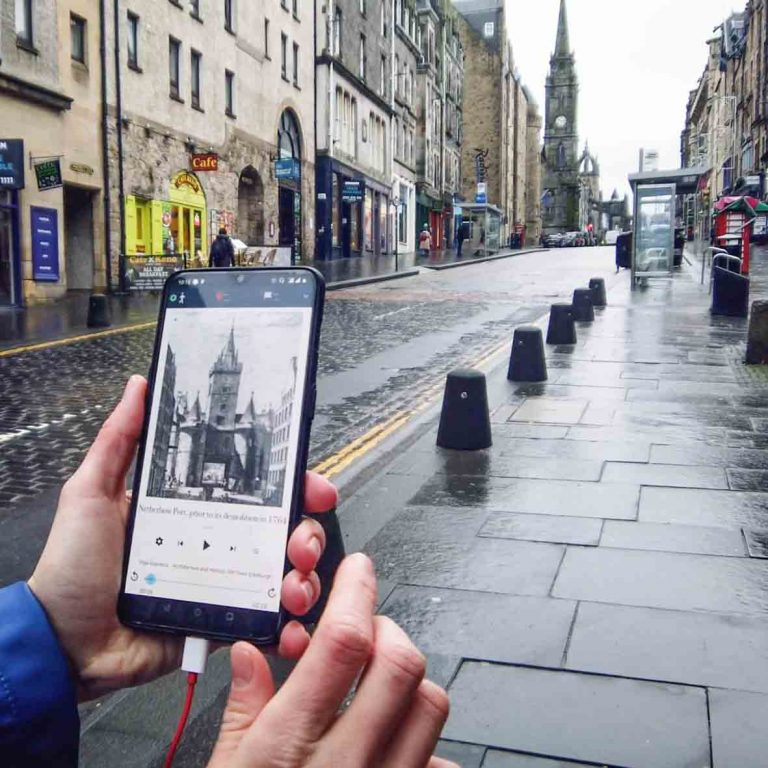 Old drawings of buildings on a self guided audio tour of Edinburgh