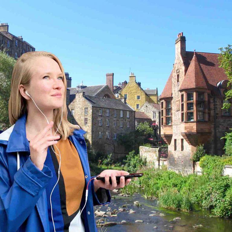 A person on audio tour of Edinburgh Dean Village